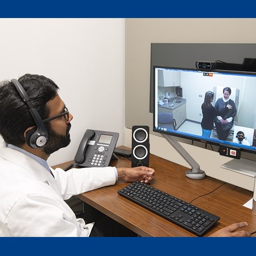 A doctor treating a patient via telehealth